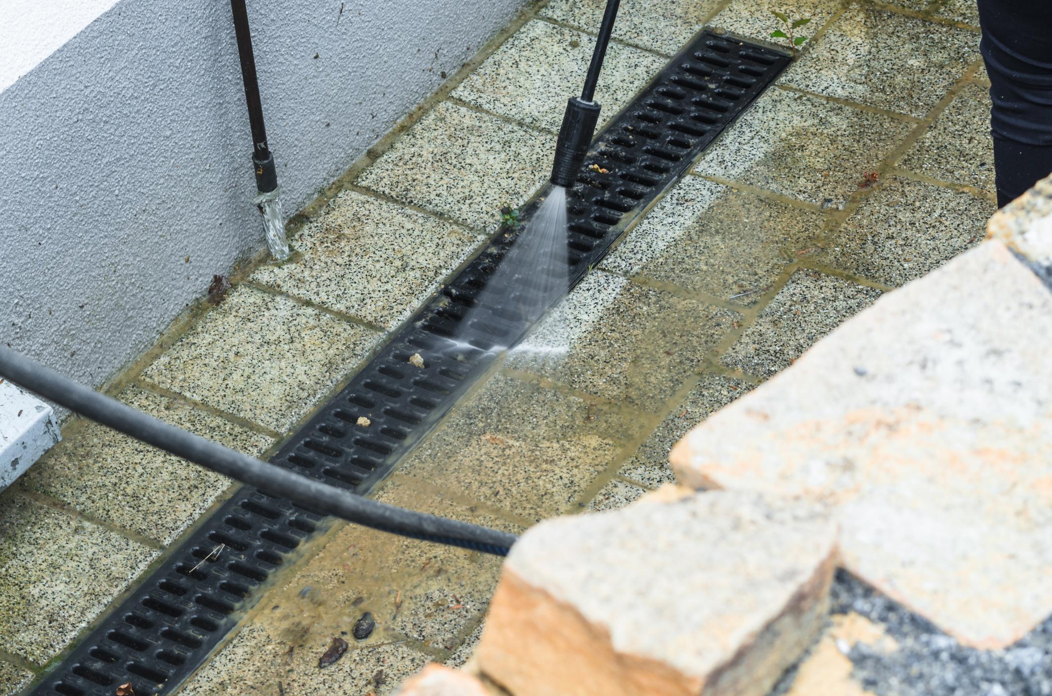 pressure washer spraying the drainage